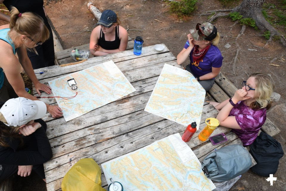 GetOutside-NavigationCourse-women-maps-compass-camping-picnic-table