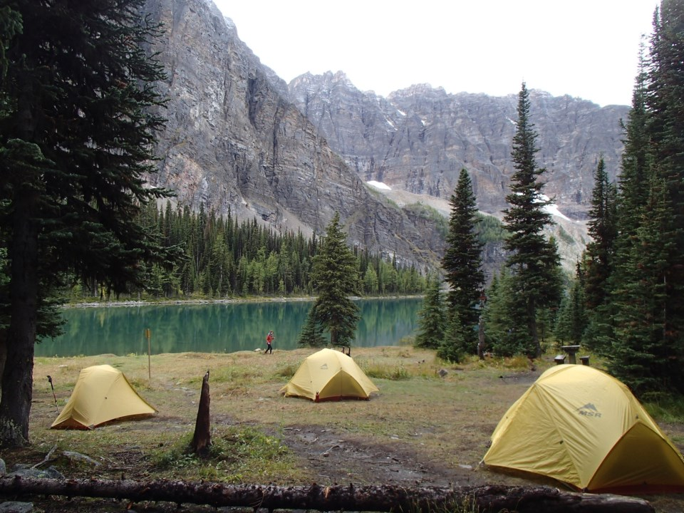 GetOutside-WomensIntroBackpacking-tents-mountains-lake-trees