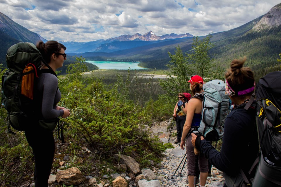 GetOutside-WomensIntroBackpacking-women-backpacking-Emerald-Lake-mountains