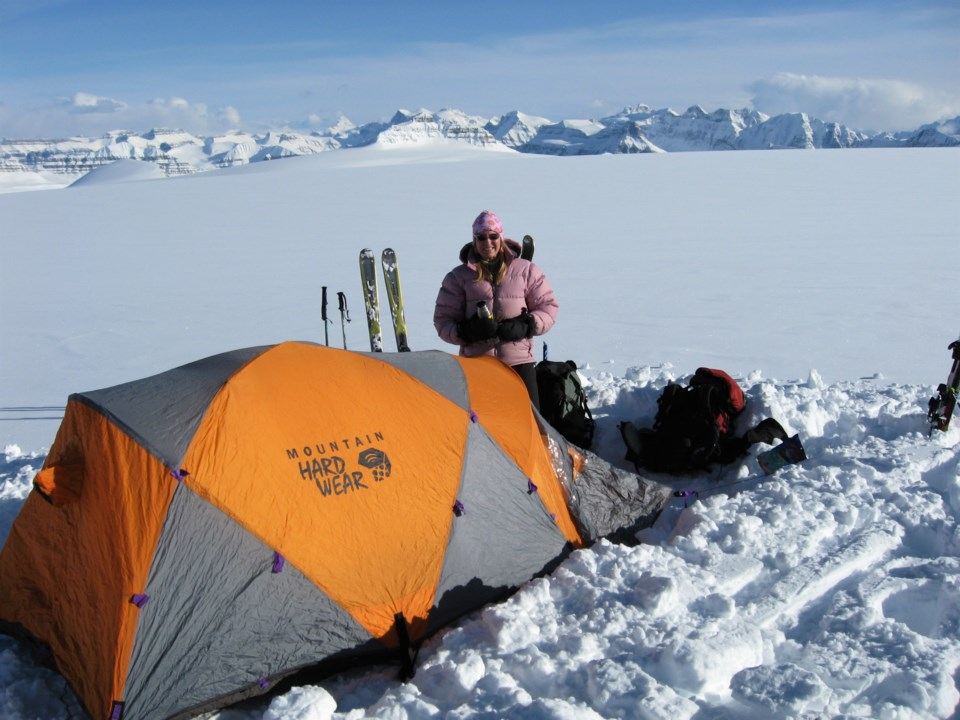 5 Stories of Ice author Lynn Martel savours the late day sun while camping at 3000 metres on the Columbia Icefield.  Photo by Gail Crowe-swords