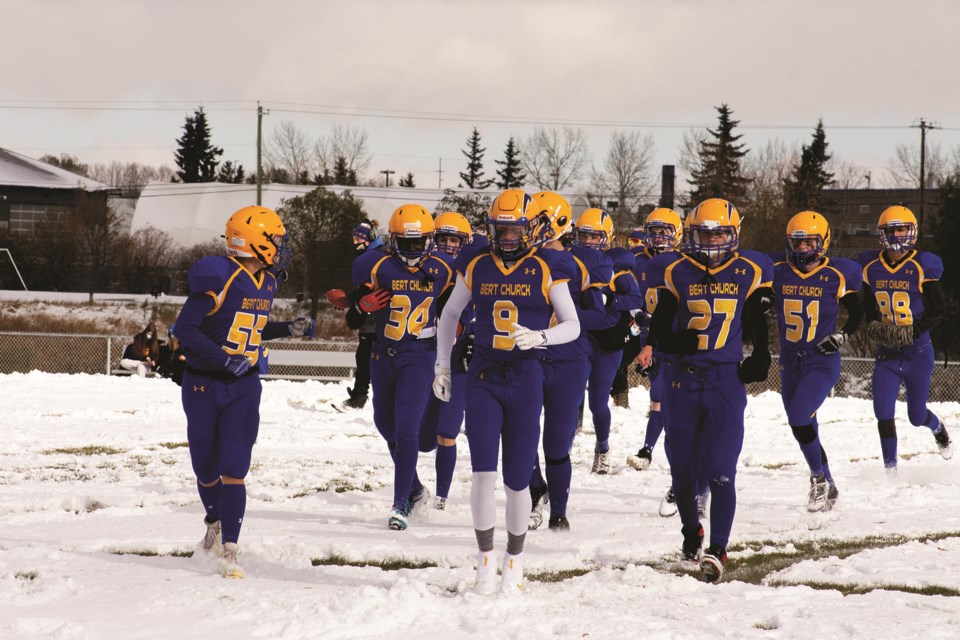 The Bert Church Chargers football team played an inter-squad match Oct. 17 at Ed Eggerer Athletic Park, dubbed the Blue and Gold Game. The Blue team won the close game 46-43. Photo by Jordan Stricker/Airdrie City View