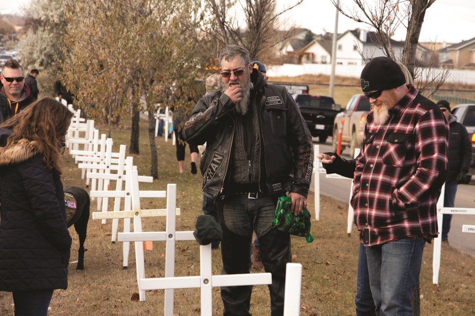 Veterans, local politicians and members of the public gathered along Veterans Boulevard Oct. 31 to install crosses and remember local fallen soldiers. Photo by Jordan Stricker/Airdrie City View