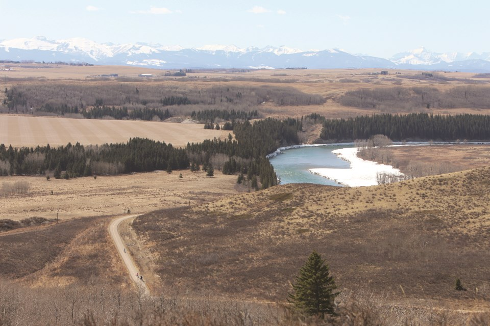 The Bow River is seen with remnants of melting ice and snow on a sunny Saturday afternoon in Glenbow Ranch Provincial Park.
