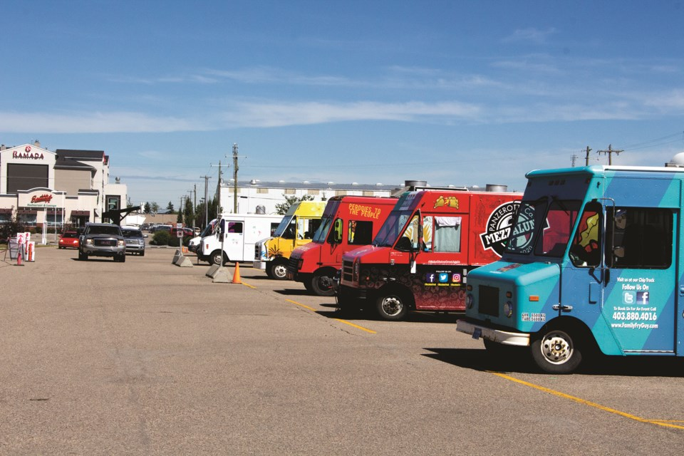The drive-thru version of the Food Truck Frenzy took place Aug. 14-16 in the parking lot of the Ron Ebbesen Twin Arena. Photo by Jordan Stricker/Airdrie City View