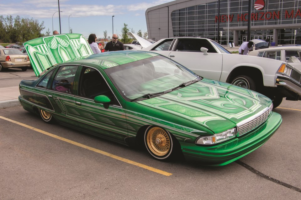 A lowrider showcases an intricate and vibrant paint job during the car show at New Horizon Mall July 25. Photo by Jordan Stricker/Airdrie City View.