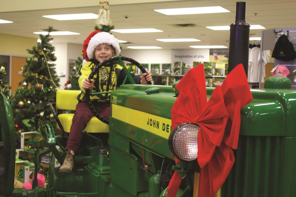 Cervus Equipment hosted its annual Green Christmas Day of Play at its store in East Balzac Nov. 7. Children and parents took advantage of bouncey houses, live music, wagon rides and a campfire, and had a chance to climb on several pieces of John Deere equipment or play with toy versions of the same machines. Photo by Ben Sherick/Rocky View Publishing