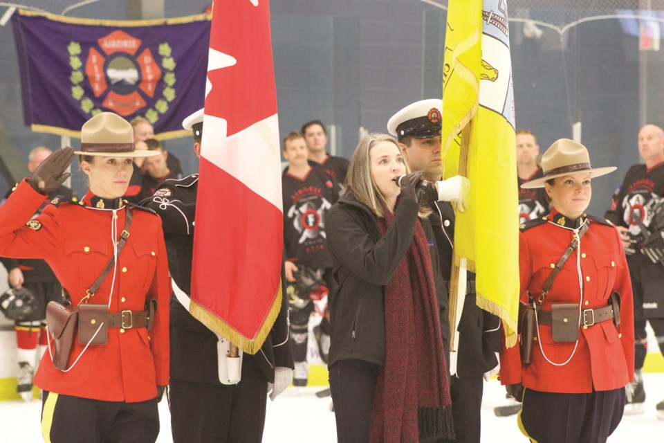 Coun. Tina Petrow opened an annual charity hockey game between the RCMP and Airdrie Fire Department with a rendition of Oh Canada Nov. 23. Photo by Ben Sherick/Rocky View Publishing
