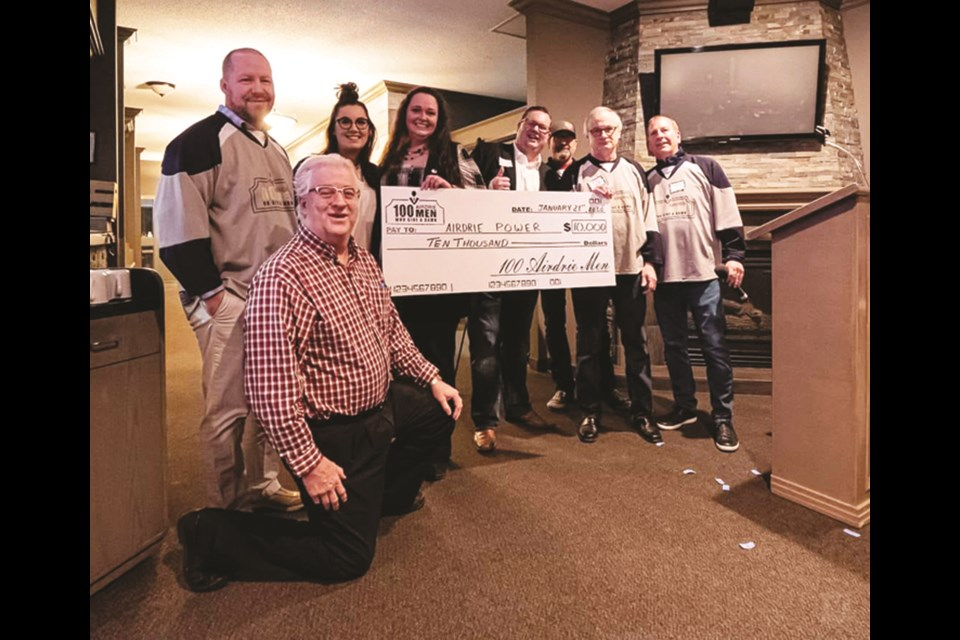 100 Airdrie Men Who Give a Damn presented $10,000 to Airdrie P.O.W.E.R. Jan. 21. The donation means the club has cracked the $100,000 threshold in total donations distributed since October 2017. Photo: Facebook