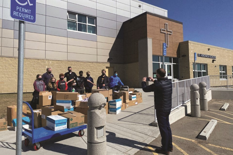 The 40 cans for Lent funrdaiser held in conjunction with the Airdrie Knights of Columbus Council 8045, St Paul's Perish and a number of Airdrie schools raised more than $18,000 in food and cash donations for the Airdrie Food Bank.