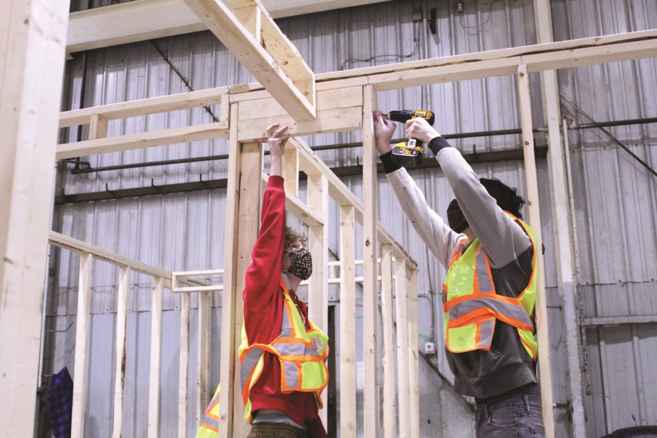 Rocky View Schools students in the division's Building Futures program are helping construct animal shelters at the Alberta Pound and Rescue Centre's new facility in Airdrie.