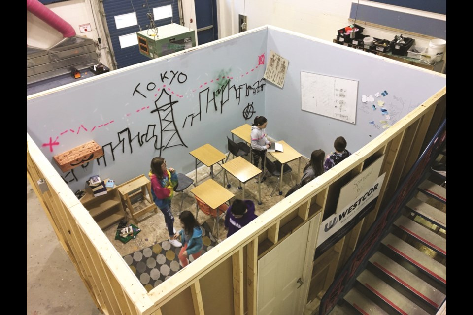 Exploratory 8 students at Muriel Clayton Middle School designed and built a full-functioning escape room this year, which was unveiled Jan. 30. The room includes up to six puzzles and riddles to be solved, within a 20-minute timespan. Photo by Scott Strasser/Airdrie City View
