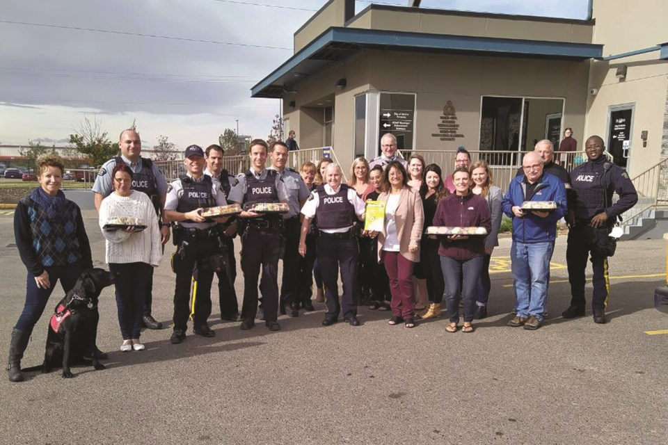 Airdrie's RCMP and Municipal Enforcement staff were surprised with lunch Oct. 9, courtesy of residents and staff of Luxstone Manor. Photo submitted/For Airdrie City View.