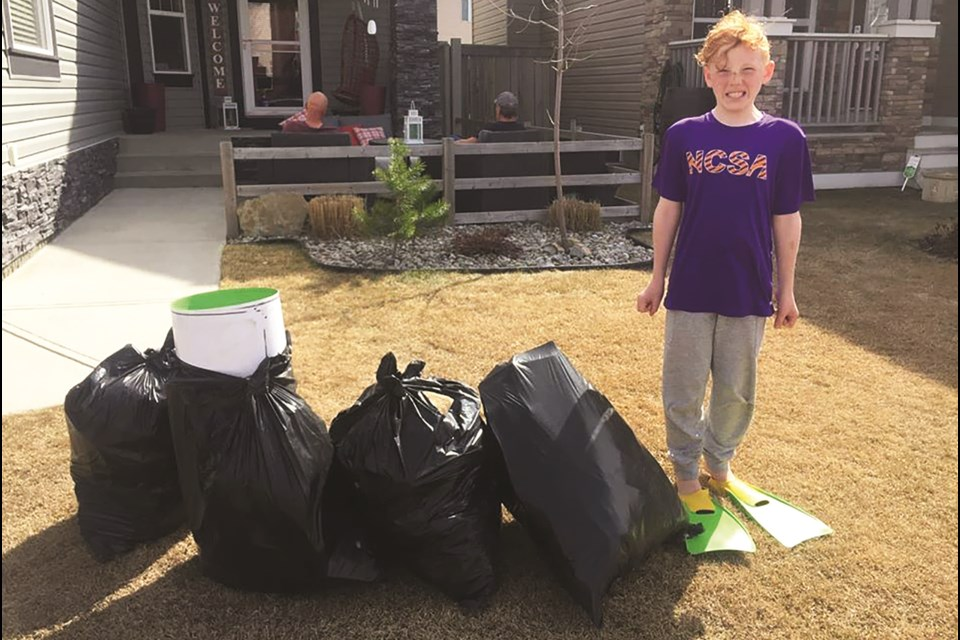 NCSA member Hunter Leggett shows off the four bags of garbage he accumulated in just 30 minutes he spent picking up trash in his neighbourhood.  Photo: Facebook