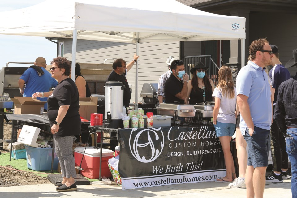 """The Castellano """"Homes for Hope"""" Stampede barbecue had Airdronians lining up for food. Photo by Kate F. Mackenzie/Airdrie City View"""