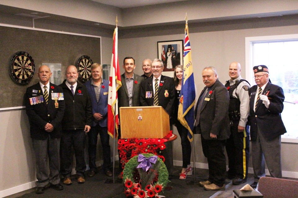 The Airdrie branch of the Royal Canadian Legion kicked off its 2019 poppy campaign Oct. 16. The annual campaign, which raised more than $92,000 last year, will run until Remembrance Day. Photo by Scott Strasser/Rocky View Publishing