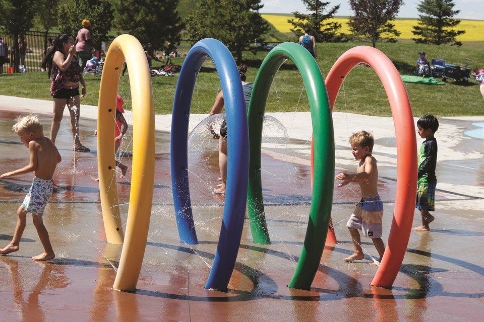 Parents and children sought out the Chinook Hills Spray Park to cool off on a hot day July 28.  Photo by Kate F. Mackenzie/Airdrie City View.
