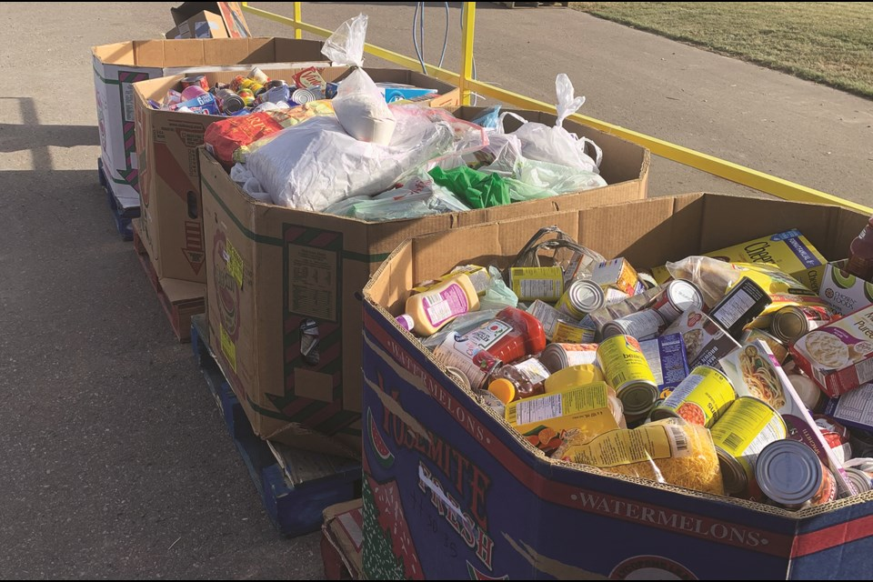 St. Veronica School donated approximately 1,800 pounds of food to the Airdrie Food Bank. Photo submitted/For Airdrie City View.