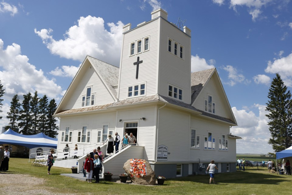 The Irricana United Church building celebrated its 100th anniversary June 16. The event began with a longer-than-usual church service in honor of its history.  Photo by Nathan Woolridge/Rocky View Publishing