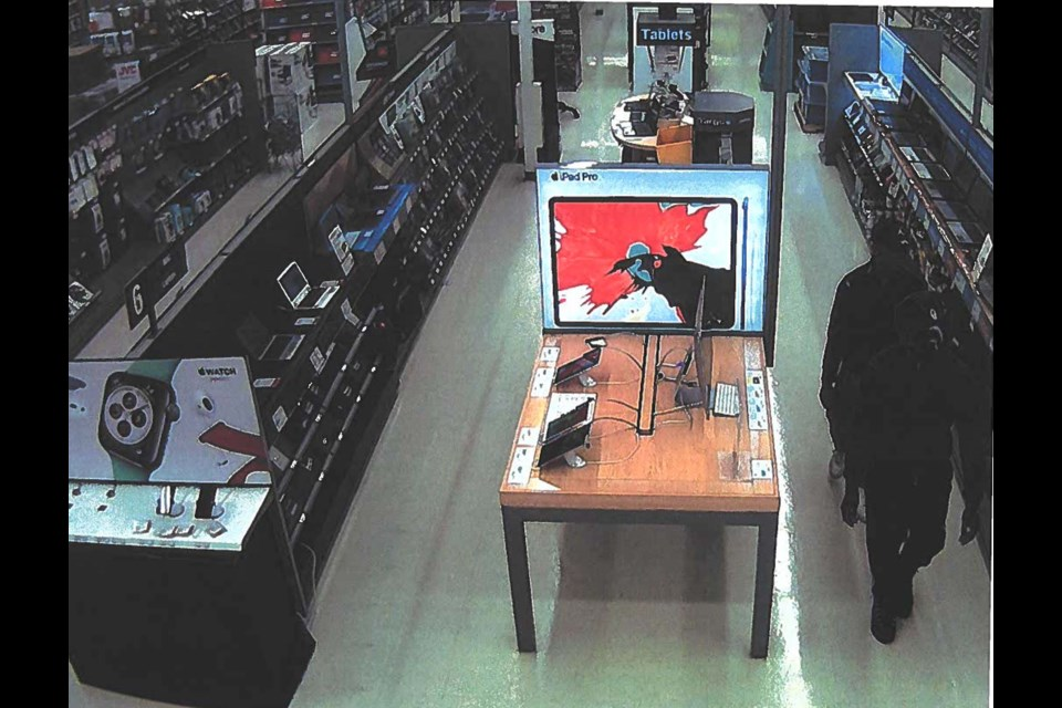 Airdrie RCMP is looking for these two men who are wanted in connection with a theft at the Staples on Main Street.