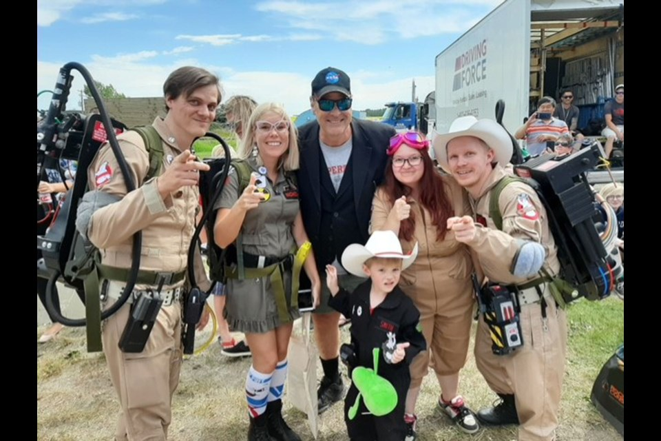 "The Calgary Ghostbusters met a familiar face in Crossfield near the set of the new ""Ghostbusters"" 2020 film – original Ghostbusters actor Dan Aykroyd.  (Back row from left) Sean Nicholson, Candace Schneider, Aykroyd, Jessica Smith, Eldon Smith and Myrick Smith (Bottom). 