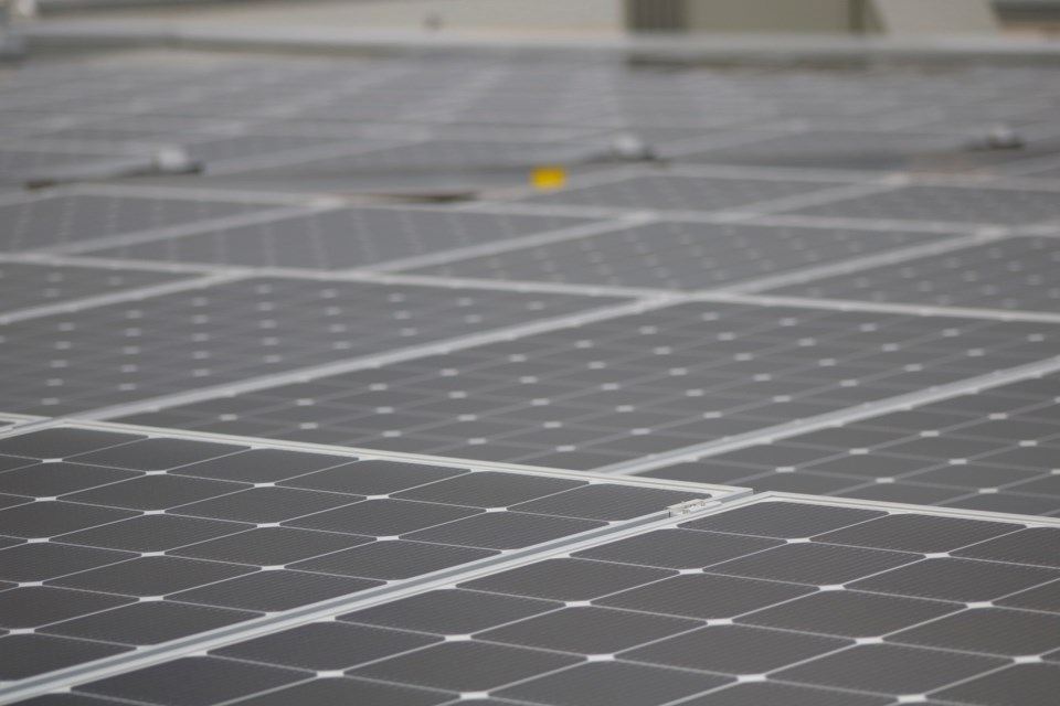 The City of Airdrie along with Enmax unveiled Canada's largest municipal rooftop solar system on top of Genesis Place Recreation Centre July 10. The system is expected to reduce the costs of the facility by $80,000.  Photo by Nathan Woolridge/Rocky View Publishing