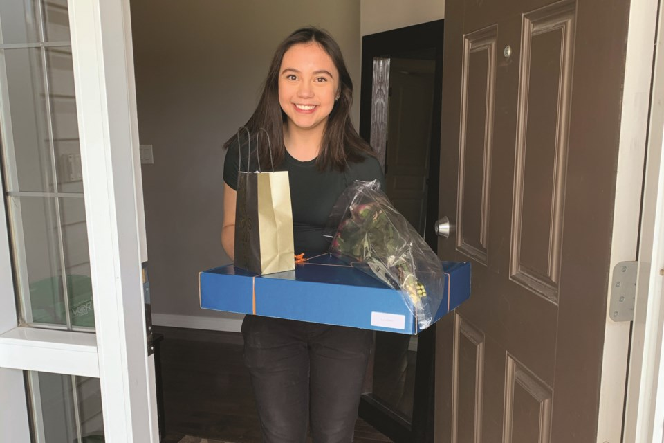 W.H. Croxford valedictorian Luca Galler shows off her grad-in-a-box package. Staff from the school delivered the boxes to the Class of 2020 June 2 and 3.