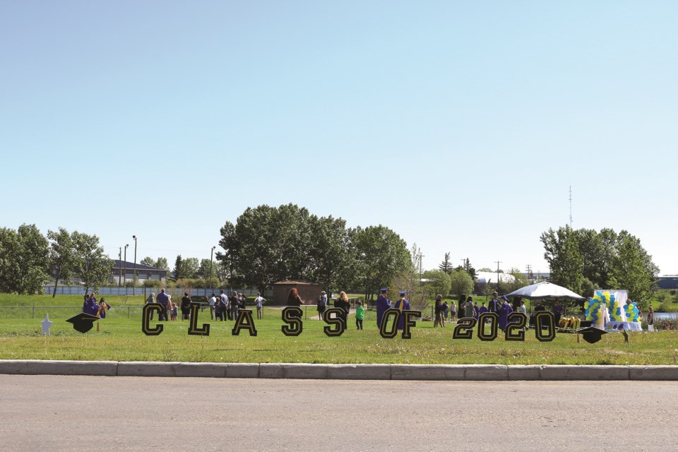 Graduates from Bert Church High school celebrated during a drive-thru ceremony at Genesis Place Recreation Centre June 20. The event was organized by parents. Photo by Kate F. Mackenzie/Airdrie City View