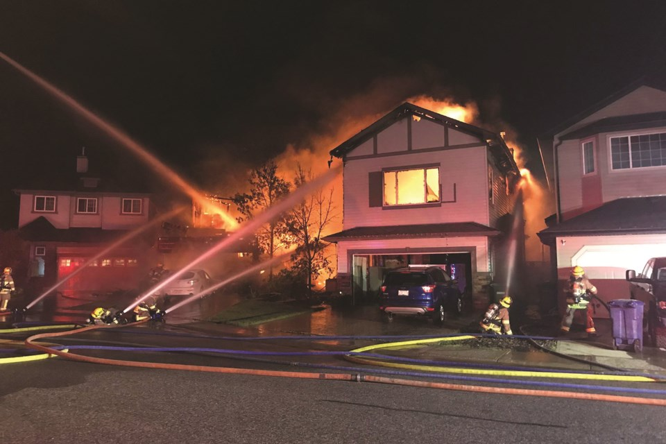Heavy winds and rain were present when the Airdrie Fire Department (AFD) were putting out the August 7 structure fire. Photo Submitted/For Airdrie City View