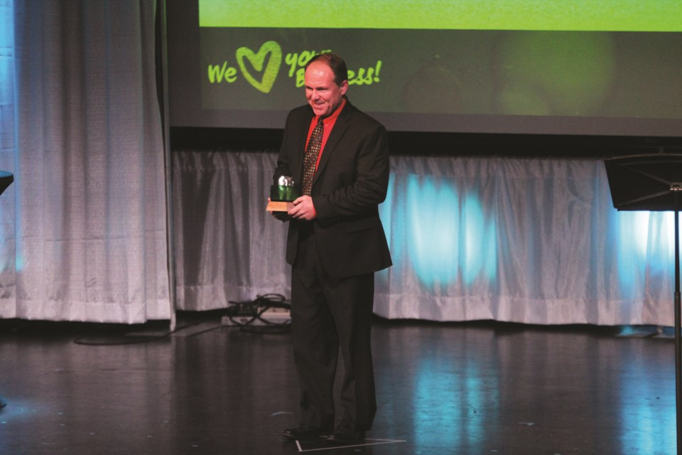 Mike Fulton accepts the Franchise Business Award on behalf of Fulton's Home Hardware Building Centre. Photo by Scott Strasser/Airdrie City View.