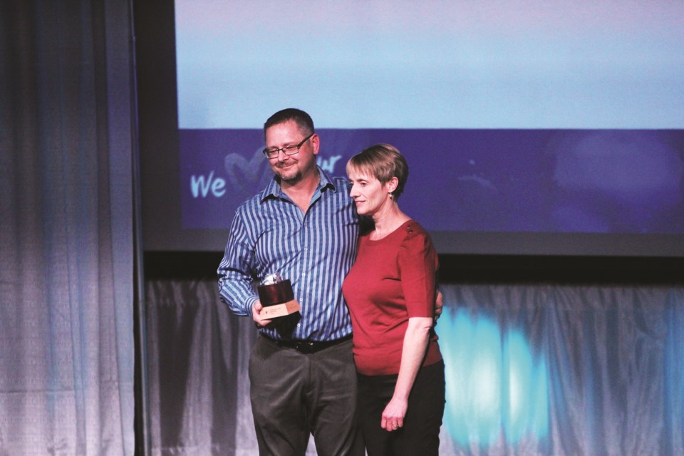 Nominations are now open for the 2021 Airdrie Business Awards. Pictured: Tires on the Run owner Roger Foster and his wife accept last year's innovation award at the Bert Church LIVE Theatre.