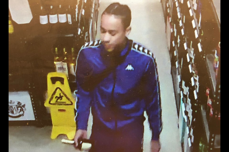 This person is the suspect in a theft of Hennessy from an Airdrie liquor store in late November. Photo Submitted/For Rocky View Publishing
