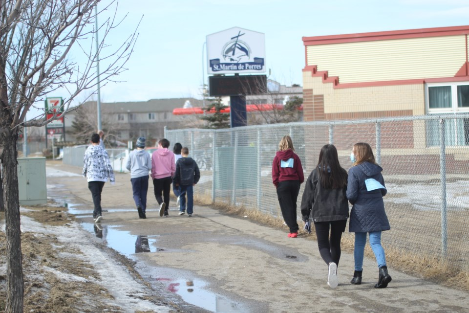 St. Martin de Porres High School students participated in the Secret 3K on March 3. The Secret 3K is an annual run-athon intended to raise awareness of gender equality in sport. Photo by Scott Strasser/Airdrie City View