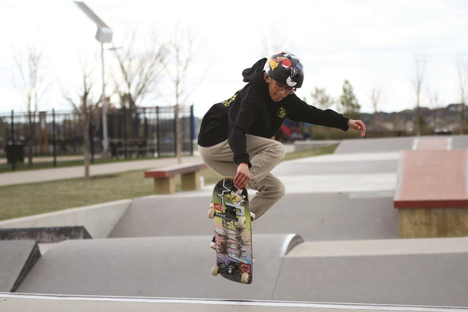 Diwan Deo, 12, goes for a grab at the Chinook Winds skate park on May 11. His advocacy last year helped bring the need for a second skate park in Airdrie to City council.