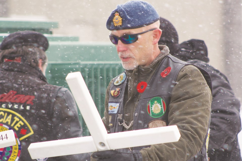 Veterans, dignitaries and members of the community braved snow and cold Oct. 26 to errect memorial crosses along Veterans Boulevard in honour of Airdrie's fallen servicemen and women. Photo by Ben Sherick/Rocky View Publishing