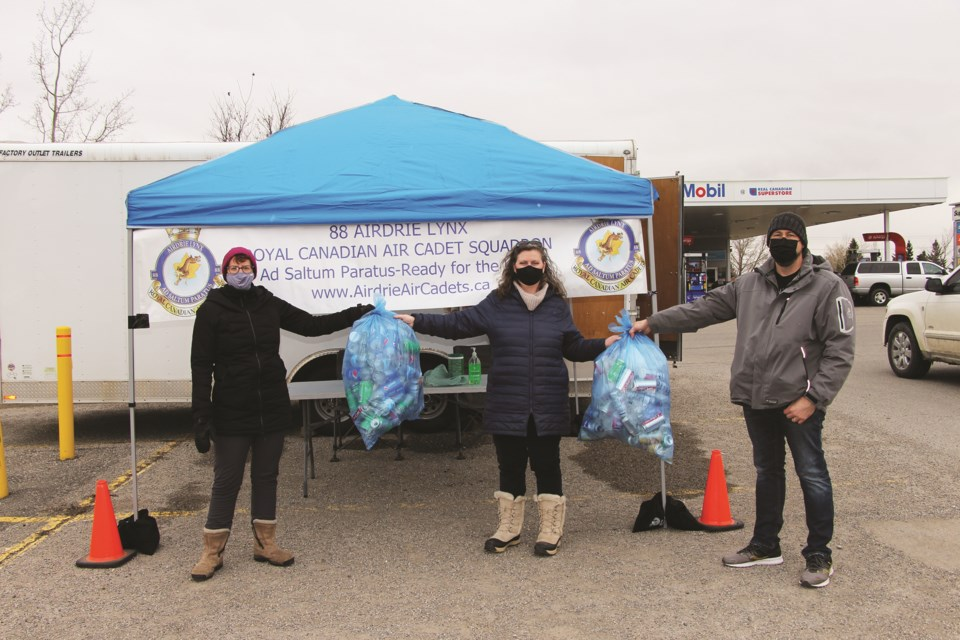 Parents volunteers gathered in the Real Canadian Superstore parking lot on April 24 from 9 a.m. to 3 p.m. to collect bottles and cash donations in support of the local air cadet squadron.