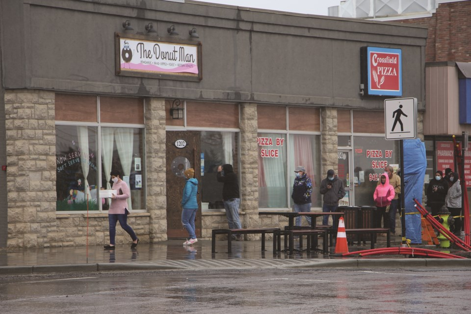 Crossfieldians withstood the wind and rain on May 8 to wait in line to purchase doughnuts from The Donut Man.