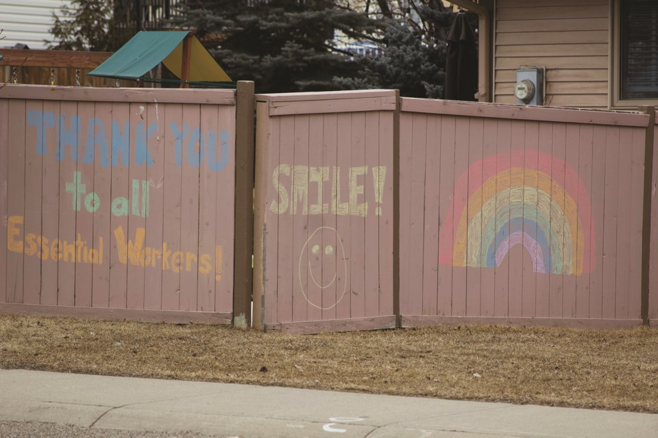 A fence in Woodside was decorated with colourful chalk displaying hopeful sentiments to passersby.