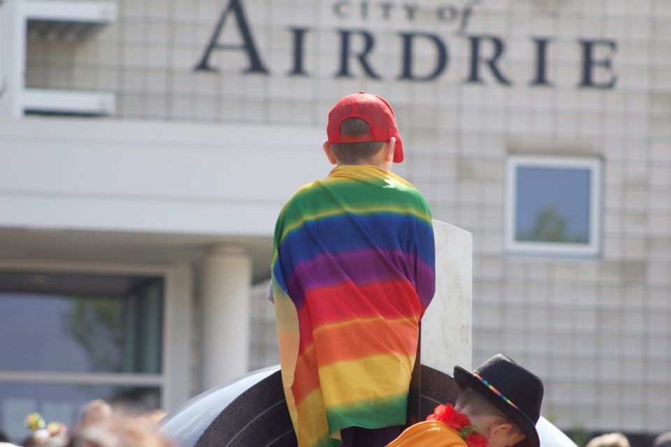 Airdrie celebrated Pride Month with the inaugural Airdrie Pride Festival June 22. Members and allies of the LGBTQ2S+ community, draped and attired in rainbows, congregated in front of City Hall to begin the day. Photo by Ben Sherick/Rocky View Publishing