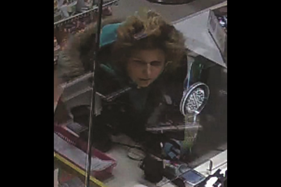 Airdrie RCMP is looking for this woman, wanted in connection with use of fraudulent credit cards in the Cooper's Plaza Oct. 27. Photo Submitted/For Rocky View Publishing