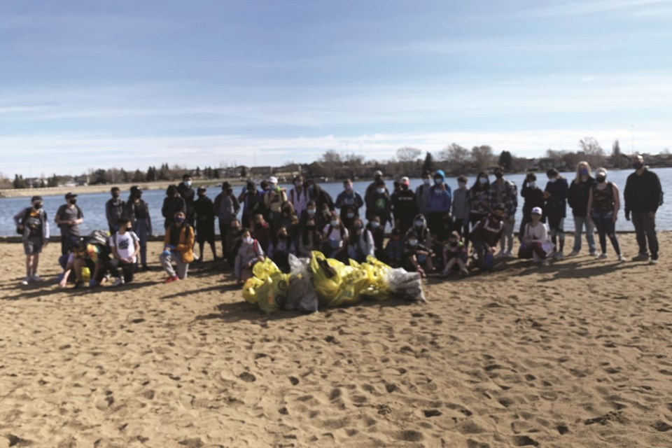 Chestermere Lake Middle School students pose during their April 29 shoreline clean-up.