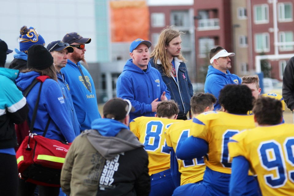 Bert Church coach Mitchell Bates addresses the Chargers players after the football team's 35-22 loss in the ASAA southern final Nov. 16 to the HTA Knights. The Chargers enjoyed its best season since 1993. Photo by Scott Strasser/Rocky View Publishing