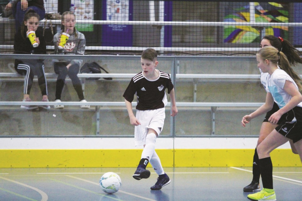 Striker Nolan Cleverley, 12, (left) is one of four soccer players from Airdrie who will compete in the 2020 Alberta Winter Games futsal tournament, Feb. 15 to 17 at Bert Church High School. Photo by Scott Strasser/Airdrie City View