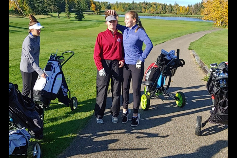 Cochrane Cobras golfer Kristine Dixon (middle) finished eighth at the ASAA provincial championships Sept. 23 and 24. She was one of eight competitors from schools in Rocky View County at the two-day-tourney.  Photo Submitted/For Rocky View County