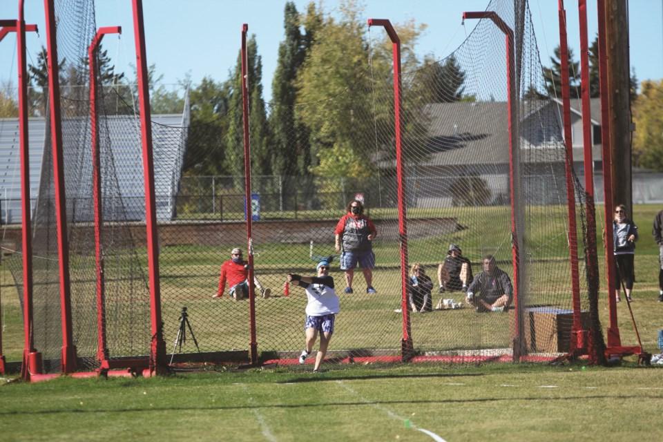 Jinaye Shomachuk, a Bert Church High School senior, set a new Alberta record for the U18 women's hammer throw Sept. 27. Photo by Scott Strasser/Airdrie City View.