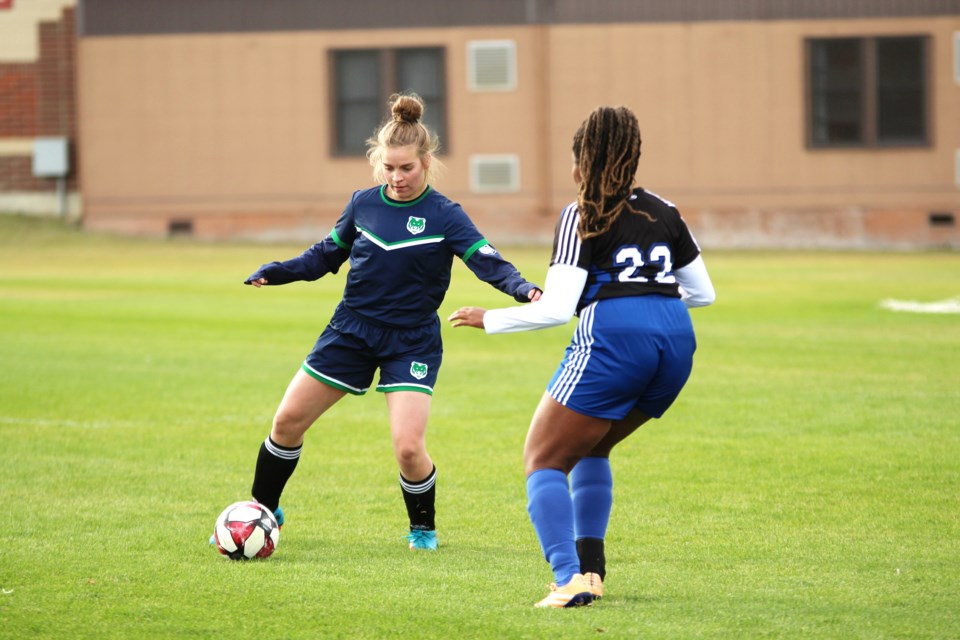 The St. Martin de Porres Kodiaks girls' soccer team tied 1-1 against Robert Thirsk Comets Sept. 26. Photo by Scott Strasser/Rocky View Publishing