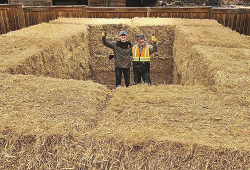 Team Canada water polo athlete Kyra Christmas and her family constructed a makeshift pool out of hay bales, landscaping fabric and other materials so she could continue her training. Photo: Instagram