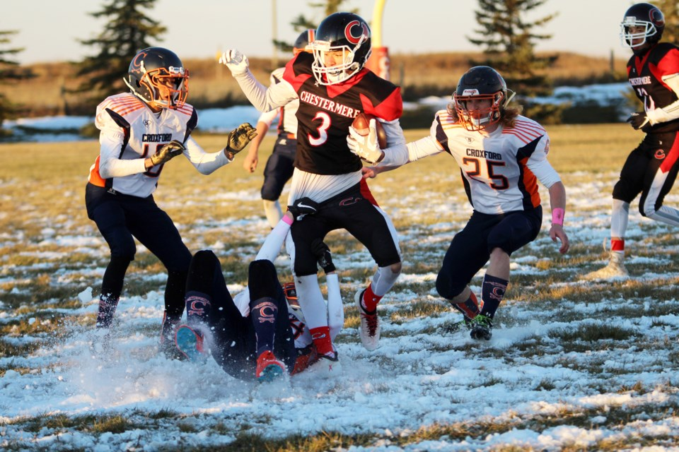 The Chestermere Lakers football team earned its second win of the season Oct. 10, defeating the W.H. Croxford Cavaliers 27-9. It was a cold evening for the game, with players battling it out in sub-zero temperatures on a snow-laden surface at Utley Field.