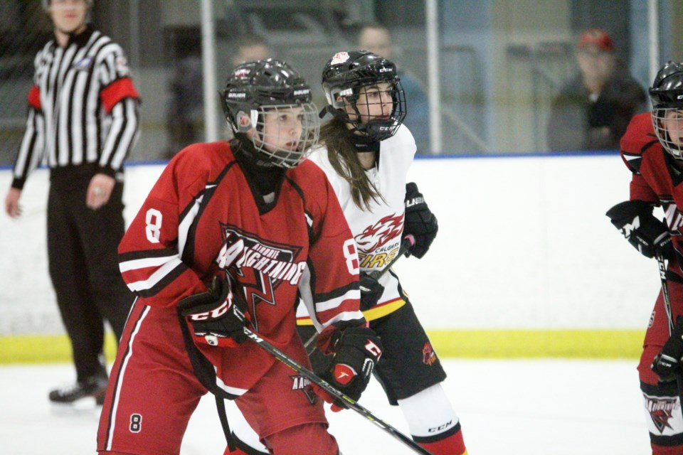 The Airdrie Lightning AA midget women's hockey team lost its home-opener 3-2 against the Calgary Fire Red, Oct. 25 at Genesis Place Recreation Centre. Photo by Scott Strasser/Rocky View Publishing