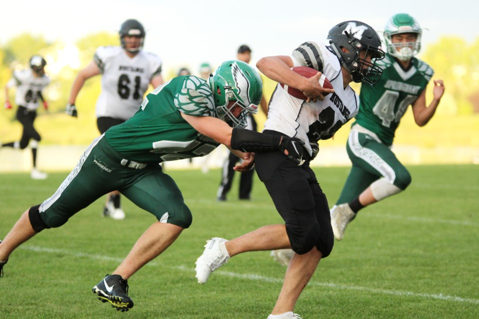 The George McDougall Mustangs kicked off the 2019 high-school football season with a 44-6 loss to the Springbank Phoenix. Photo by Scott Strasser/Rocky View Publishing
