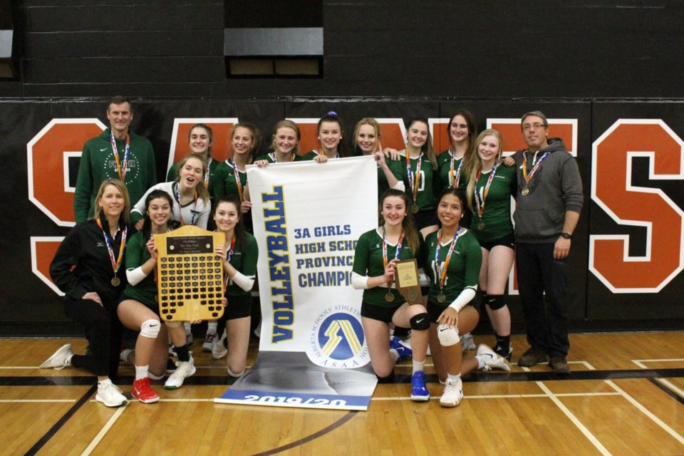 The Springbank Phoenix senior girls' volleyball team capped off a stellar season by winning the ASAA 3A provincial championship, Nov. 26. The achievement marks Springbank's first provincial banner in senior girls' volleyball. Photo Submitted/For Rocky View Publishing
